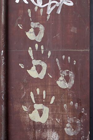 Traces of drawn hands on wall, symbolism of union and hope photo
