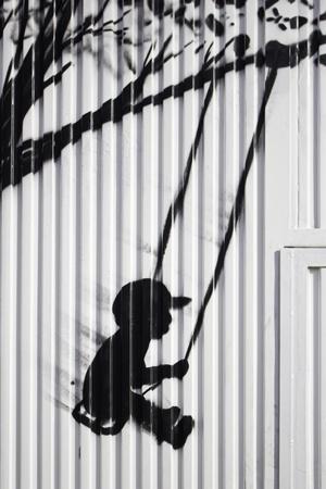 door swings: Child on swing drawn on door, silhouette and urban art