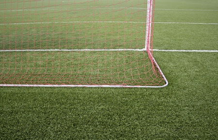 relive: Red nets goal in soccer field, sport and hobby