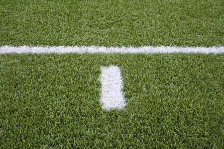relive: Signal in football painted on artificial turf, sports and hobby field