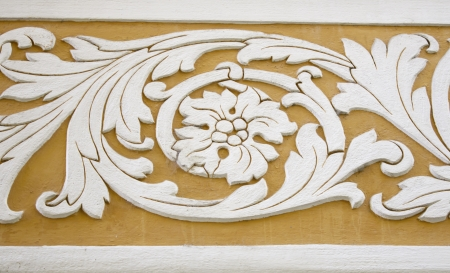 Wall carved with shape of flower and leaves in old building, art and construction