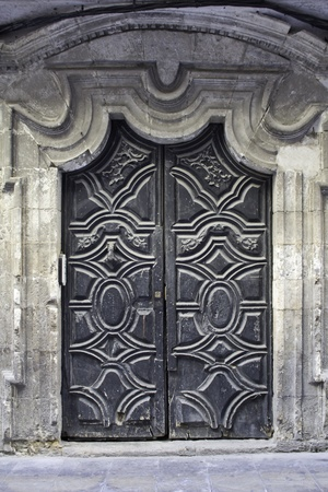 wood texture background: Door wood carved at the entrance of an ancient building, architectural construction