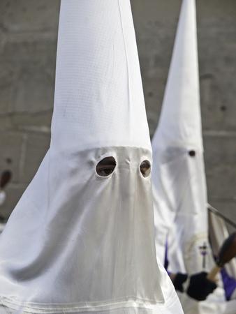 fanaticism: Clogged nazarenes in procession, Spanish religious tradition, religion Stock Photo