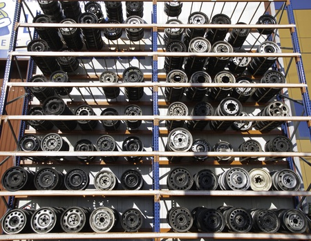 dismantling: Mechanical workshop with shelving rims and wheels on the outside, industrial building Stock Photo
