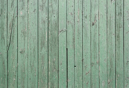 Green wooden door with chipped tables, input housing photo