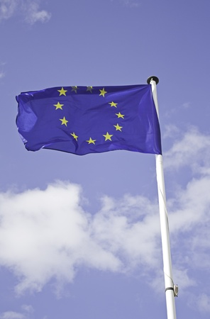 Flag of europe on white stick metal, geography and nationality photo