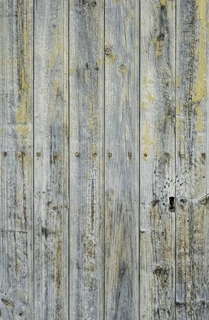 Dark wooden door in old rural building, construction photo