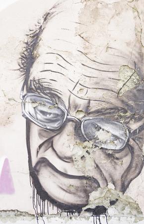 crestfallen: Old man with sorrowful look graffiti, artistic decoration