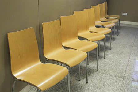 Wooden chairs in the waiting room, interior building photo
