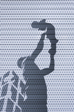 Father with son silhouette drawn on wall decor photo