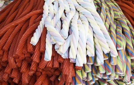 soft sell: Licorice with different colored sugar, candy Stock Photo