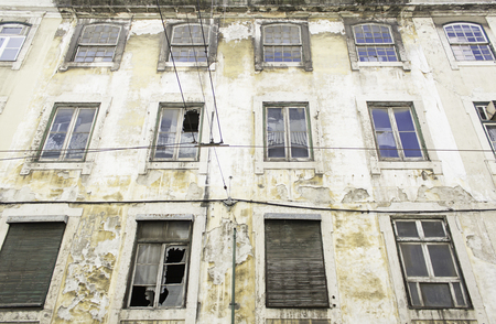 cracking: Cracked old building in Lisbon urban street Stock Photo