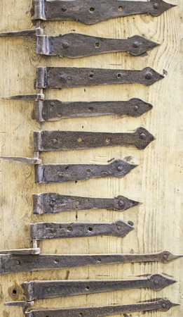 hinge joint: Rusty hinges and aged iron, security and decoration