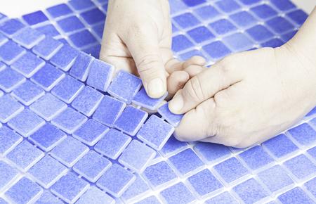Manipulating tiles for pools, worker workman