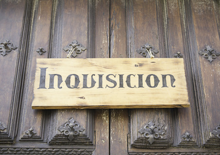inquisition: Wooden signboard Inquisition in old building Stock Photo