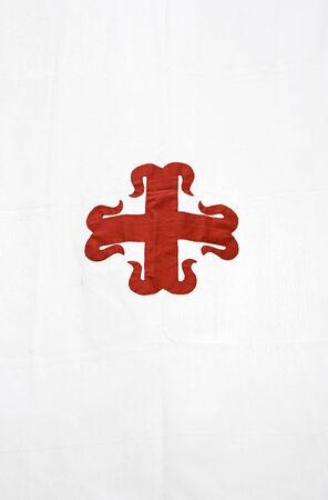Templar red cross on white cloth, history photo