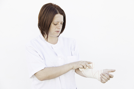 fracture arm: Girl bandaged arm in medical clinic, fracture