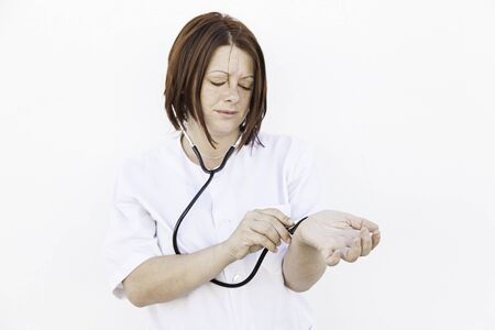 Nurse with stethoscope wearing gown, medicine and health photo