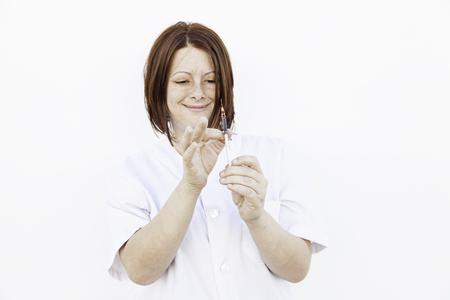 prick: Nurse with needle to prick, medicine and health Stock Photo