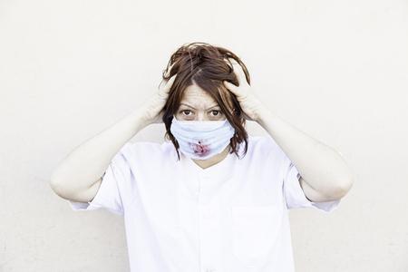 insane insanity: Crazy nurse with bloody mask, halloween