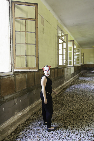insanity: Clown in abandoned house and ruined halloween Stock Photo