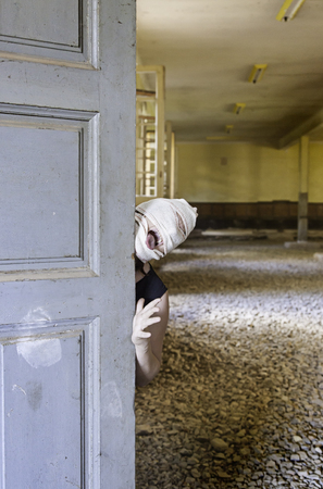 insane insanity: Murderer hiding in abandoned house door, halloween Stock Photo