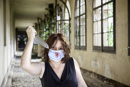 girl with knife: Psycho girl with knife and medical mask