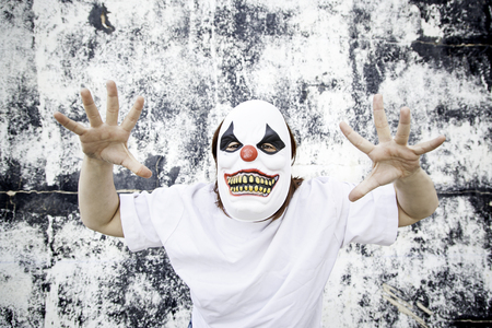 fear: Crazy clown mask halloween costume and fear