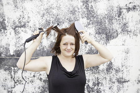 combing hair: Girl combing hair irons, fashion and beauty