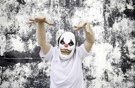 Crazy clown mask halloween costume and fear
