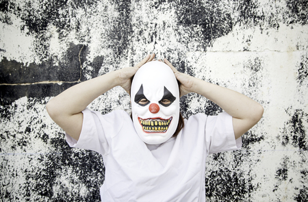 insanity: Crazy clown mask halloween costume and fear