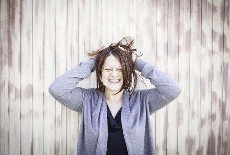 disheveled: Disheveled girl screaming in urban street fashion Stock Photo