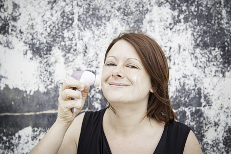 Woman giving wrinkle face cream, beauty photo