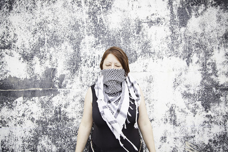 palestinian: Palestinian woman with scarf on urban street