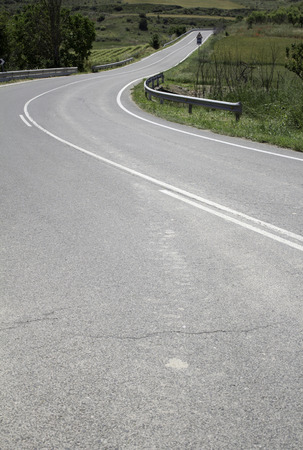 curve: Curve of road surrounded by countryside, transport Stock Photo