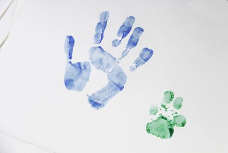 adoption: Handprint and dog painted on paper, animal adoption Stock Photo