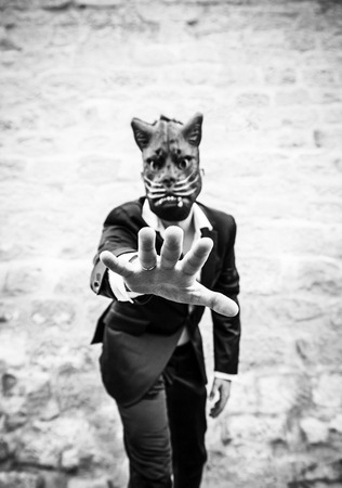 insane insanity: Male black cat mask, fear and terror Stock Photo