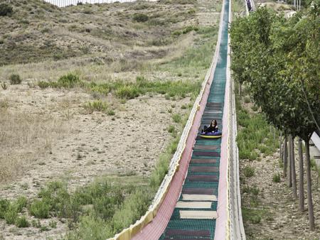 calgary stampede: Woman on giant amusement park slide, fun