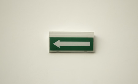 Exit arrow inside building, sign and symbol