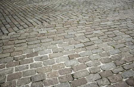 Flooring stone floor tiles in city street, construction