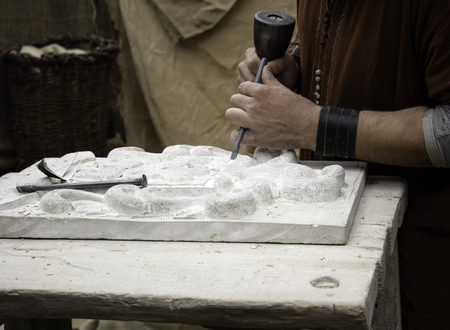 Carving stone in a traditional way, craftsmanship detail, shaping the stone Stockfoto