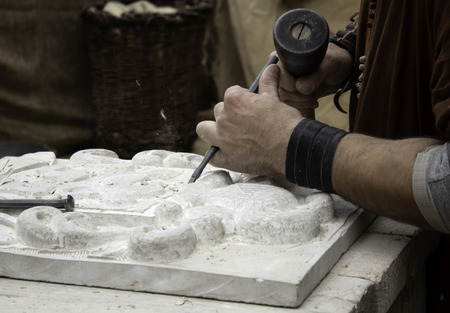 Carving stone in a traditional way, craftsmanship detail, shaping the stone Stock Photo