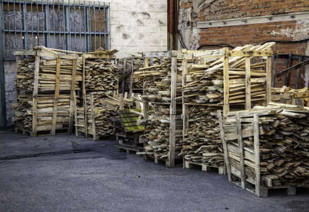 Wooden boards stacked in factory for recycling, environment and construction