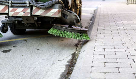 Industrial vehicle sweeper in urban street, cleaning and disinfection