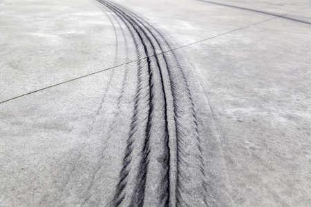 Wheel tracks on urban street, vehicle skidding, texture