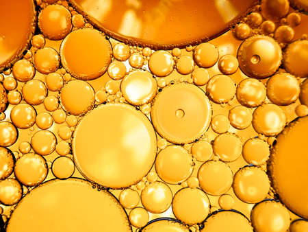 gold yellow beer oil organic abstract texture pattern bubbles macro Imagens