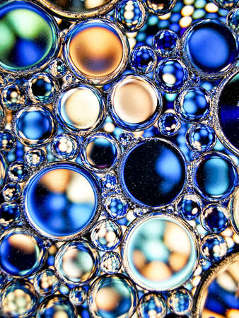 blue oil bubbles on liquid abstract texture for background