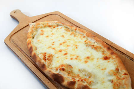 grilled baked cheese pizza called pide turkish cuisine white background Stock Photo