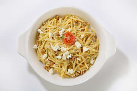 white cheese topped pasta