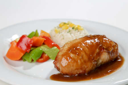barbeque sauced chicken roll with side dish white background